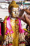 Sprinkle water onto a buddha. The Songkran festival Songkran has traditionally been celebrated as the New Year Royalty Free Stock Image