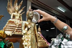 Sprinkle water onto a Buddha in Songkran festival day. Sprinkle water onto a Buddha in Songkran festival Stock Photos