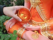 Sprinkle water onto a Buddha statue ,Songkran Stock Photos