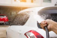 Sprinkle with water to wash the car by hand. stock photo