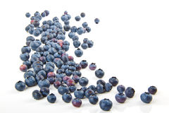 Sprinkled blueberries. Blueberries, spilling on the white surface Royalty Free Stock Photography