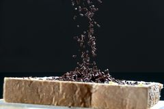Sprinkled chocolate on a sliced bread royalty free stock photo