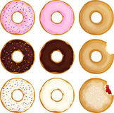 Sprinkled Frosted Donuts. Nine various donuts, including sprinkled, frosted, glazed, and jelly Royalty Free Stock Photos