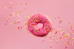 Sprinkled Pink Donut stock images