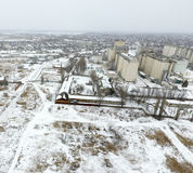 Sprinkled with snow grain elevator. Winter view of the old Soviet elevator. Winter view from the bird's eye view of the village.  Stock Photography