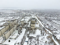 Sprinkled With Snow Grain Elevator. Winter View Of The Old Soviet Elevator. Winter View From The Bird S Eye View Of The Village. Royalty Free Stock Photography