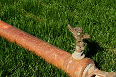 Sprinkler. Industrial sprinkler system on a nice green grass Stock Photo