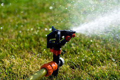 Sprinkler. Garden working with sprinkler outdoor Stock Photography