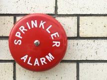 Sprinkler alarm bell on a building brick wall Stock Photos