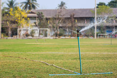 Sprinkler in football field Royalty Free Stock Photography