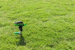 Sprinkler in the garden. Wait for user Royalty Free Stock Images
