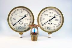 Sprinkler head and gauges. Two sprinkler gauges and sprinkler head over white background Royalty Free Stock Photos