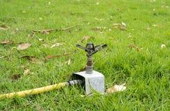 Sprinkler hose Stock Images
