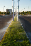 Sprinkler Irrigation in the Middle of an Avenue Royalty Free Stock Photo