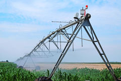 Sprinkler irrigation system on agriculture field Stock Images