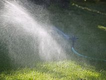 Sprinkler in Operation Stock Images