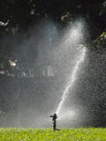 Sprinkler in park Stock Photography
