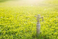 Sprinkler. The plastic sprinkler is on the grass and stopped working Royalty Free Stock Photo