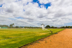 Sprinkler spraying lawn. Stock Photography