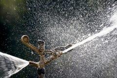 Sprinkler spraying water Royalty Free Stock Image