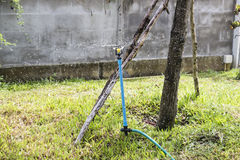 Sprinkler spraying water Royalty Free Stock Photo