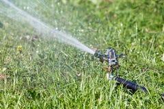 Sprinkler spraying water Royalty Free Stock Photo