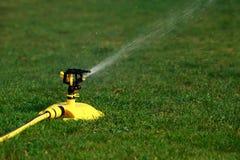 Sprinkler spraying water Stock Photos
