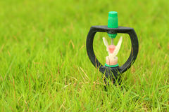 Sprinkler is stuck in in the grass. Sprinkler is stuck in in the grass Royalty Free Stock Images