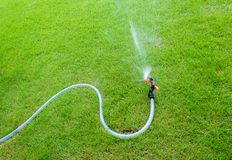 Sprinkler watering in the garden.On the lawn royalty free stock photography