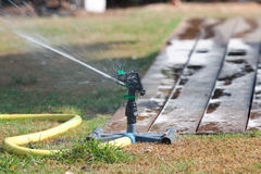 Sprinkler watering grass Royalty Free Stock Images