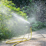 Sprinkler watering the plants Royalty Free Stock Photography