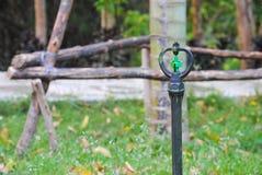 Sprinkler watering tool in garden. Sprinkler watering tool in grass garden Stock Images