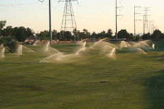 Sprinklers. Several sprinklers working at the same time on the field Royalty Free Stock Images