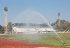 Sprinklers on the football pitch Royalty Free Stock Photos