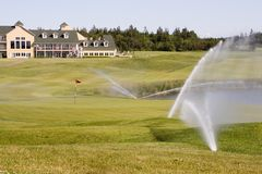 Sprinklers on a Golf Course Royalty Free Stock Image