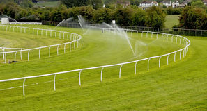 Sprinklers on racecourse Stock Photos