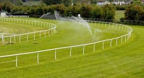 Sprinklers on racecourse stock photos
