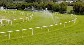 Sprinklers on racecourse Stock Image