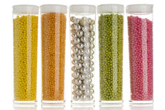 Sprinkles. Containers of cake decorative sprinkles on white Royalty Free Stock Photo