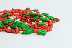 Sprinkles alpha. Red white and green cake decorations stock photography