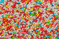 Sprinkles colored balls. Sprinkles different colors sweet balls Royalty Free Stock Photos