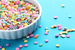 Sprinkles. Colorful sprinkles on a blue background Royalty Free Stock Images