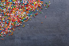 Sprinkles. Colorful sprinkles on a grey wooden table Stock Photo