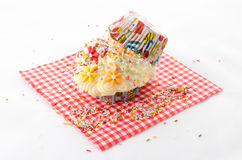 Sprinkles - cupcake folded. Two cupcake buttercream on a red patterned napkin and flower -  folded Royalty Free Stock Photo