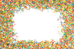 Sprinkles frame. White blank copy space framed by colorful frame of sugar sprinkles Royalty Free Stock Photo