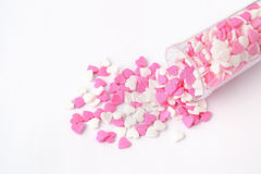 Sprinkles heart in open pill bottle, love is medicine Stock Images