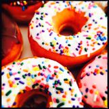 Sprinkles on ring donuts stock image