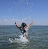 She sprinkles in seawater Royalty Free Stock Image