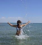 She sprinkles in seawater Royalty Free Stock Photo