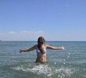 She sprinkles in seawater Royalty Free Stock Photos